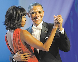 President Barack Obama dances with first lady Michelle Obama during The Inaugural Ball at the Washington Convention Center during the 57th Presidential Inauguration festivities in Washington on Monday.