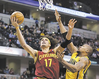 The Cleveland Cavaliers' Anderson Varejao (17) puts up a shot against the Indiana Pacers' David West during the first half of a game in Indianapolis. Varejao will miss the rest of the season after a blood clot was found in his right lung.