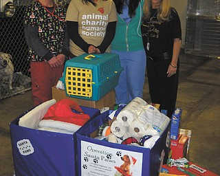 Nikki Harley, left, Shalyse Bolash, Talia Musolino, Paula Blakeman, Shepherd of the Valley Poland activity/volunteer director and Operation Santa Paws organizer, are shown with donations received for Animal Charity from SOV's Operation Santa Paws.