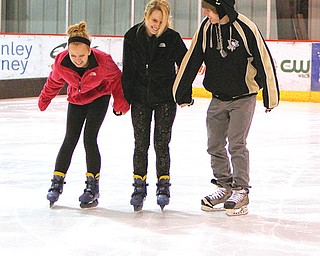 Unusually cold conditions Tuesday closed most Mahoning Valley schools. As a results, many students hit the ice at the indoor Ice Zone in Boardman. At left, from left, Taylor Vanasdale, 14; Alexis Madeline, 17 and Jared