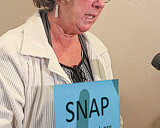 Judy Jones member of SNAP, Survivors Network of those Abused by Priests, speaks outside the Mahoning County prosecutor's office Tuesday. Jones said SNAP has gotten new reports of sex abuse in the Youngstown Diocese.
