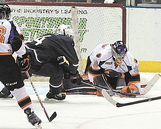 Phantoms goaltender Sean Romeo stops a shot by Team USA's Tyler Motte during a Dec. 21 game at the Covelli Centre. Romeo's two game suspension is over and he'll be in goal on Friday against the Indiana Ice.