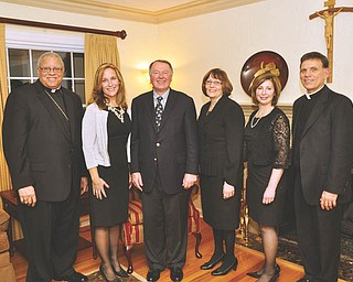 St. Joseph the Provider School in Youngstown recently sponsored a wine and cheese tasting fundraiser for school benefactors. Shown, from left, are Bishop George V. Murry; Patti Wanat, chairwoman of the school board of directors; Richard Burke, president, Catholic School Management of Madison, Conn., who provided the wine tasting; Cheryl Jablonski, school principal; Mimi Kerrigan, chairwoman for the event; and the Rev. Michael Swierz, school president. Chef Michael Alberini of Boardman catered the event, which featured a video about the school made by Rich Hahn of Keynote Media in Youngstown. For information on the school, visit stjoesjaguars.com or call 330-259-0353.