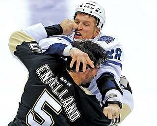 Pittsburgh Penguins defenseman Deryk Engelland (5) and the Toronto Maple Leafs Colton Orr (28) throw