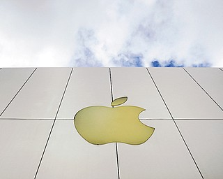 The Apple logo is seen on an Apple store in San Francisco. Apple shares plunged Thursday after the company reported quarterly results that point to slowing growth after five blowout years.