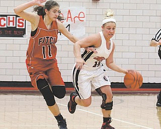Canfield's Paige Baker (10) tries to get past Fitch defender Megan Sefcik (11) during their basketball game Thursday at Canfield High School. The Cardinals defeated the Falcons, 63-57.