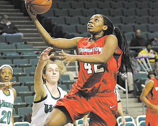Youngstown State's Brandi Brown (42) goes for the layup against Cleveland State's Haley Schmitt (40) during the first half of Thursday's game at the Wolstein Center in Cleveland. The Penguins bested the Vikings 72-63 with help from Brown, who matched her season high with 28 points and added 17 rebounds.