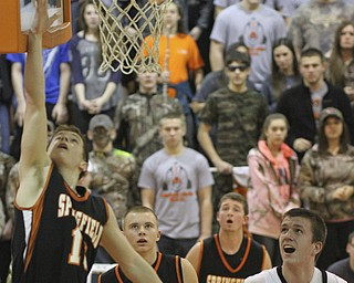 William d Lewis the Vindicator  Springfield's Eoghan Bees (13) puts up a basket during 1 rst half action Tuesday at Ridge.