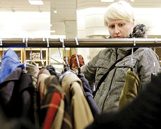 In this Jan. 20 photo, a woman shops at a Nordstrom store in Chicago. U.S. consumer confidence plunged in January to its lowest level in more than a year, reflecting higher Social Security taxes that left Americans with less take-home pay.