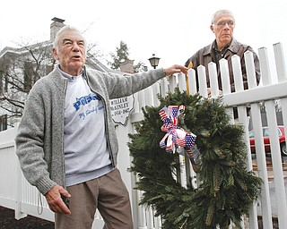 Ted Heineman, left, and Dave Smith place a wreath where President William McKinley's boyhood home once stood in celebration of McKinley's 170th birthday. Both men are members of the Poland Historical Society and Town One Streetscapes, which organized Tuesday's commemoration. McKinley, pictured top left in his Civil War uniform, graduated from Poland schools and later worked as a postal clerk and teacher in Poland.