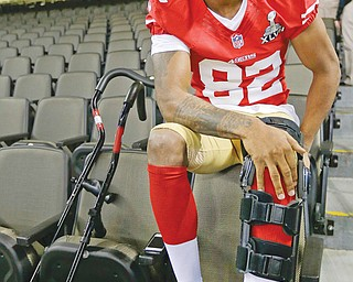 San Francisco 49ers wide receiver Mario Manningham answers reporters' questions from the seats of the Mercedes Benz Superdome on Tuesday during media day for Super Bowl XLVII. Manningham, a Warren Harding graduate, will be sitting out Sunday's big game after suffering a knee injury during a regular-season game against Seattle.