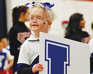 The Fairhaven School student body, along with staff and parents cheered as the school's Bulldogs mixed it up on the basketball court Wednesday with athletes from Girard High School during the second annual Winter Classic exhibition basketball game. Participating from Fairhaven, include cheerleader Erin Pessell.