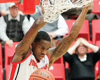 YSU's Kendrick Perry (3) dunks the ball during the fi rst half of Wednesday's game against Horizon League leader Valparaiso at YSU's Beeghly Center. Perry posted 28 points and grabbed 11 rebounds for the Penguins, who knocked off the No. 1 Vikings, 80-68.