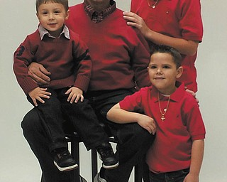 Christopher, Dominic, Tom and Santino, dressed in red.