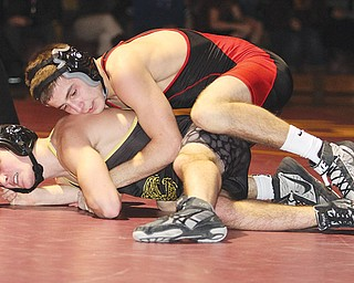 Girard's Zane Chase (top) tries to get position against Liberty's Robby Kurtz during their 120-pound match Wednesday night. Chase won a 13-3 major decision and the Indians beat the Leopards, 43-27.