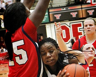 MADELYN P. HASTINGS | THE VINDICATOR  Youngstown's Brandi Brown (42) attempts to shoot the ball while Detroit's Yar Shayok (25) defends during the second half of the game at the Beeghly Center on February 7, 2012. The Penguins beat the Titans 58-53.