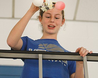 Melissa Thomas drops her egg capsule during an egg-drop contest at Hubbard community pool. Hubbard High School hosted its first science festival Thursday.