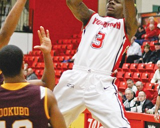 Youngstown State's Kendrick Perry (3) leans back for a jump shot while being defended by Loyola's London Dokubo (13) during the second half of their Horizon League game Thursday at YSU's Beeghly Center. A 3-pointer by Blake Allen with 12 seconds remaining gave the Penguins the 60-59 win over the Ramblers. Perry finished with a team-high 18 points.
