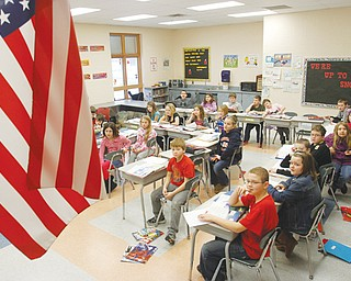 Students in Matt Vukovic's class at Roosevelt Elementary in McDonald listen to a science lesson. The U.S. Department of Education has selected Roosevelt to represent Ohio and the nation's fourth-graders on the National Assessment of Educational Progress. The test will be given to them Tuesday.
