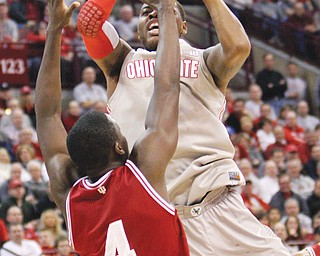 Ohio State's Deshaun Thomas shoots over Indiana's Victor Oladipo during the first half of their Big 10  Conference basketball game Sunday in Columbus. Both Oladipo and Thomas put up 26 points — a career best for Oladipo — but the No. 1 Hoosiers bounced the No. 10 Buckeyes, 81-68.