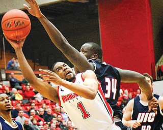 Youngstown State's Blake Allen (1) is closely guarded by UIC defender Josh Crittle (34) during the second half of Sunday's game at YSU's Beeghly Center. The Penguins went down to the Flames 88-83 in triple overtime.