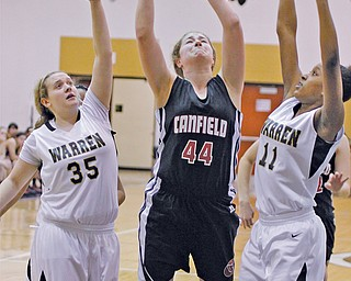 Canfield's Sabrina Mangapora (44) goes up for a shot as Warren Harding's Chelsea Dipaolo (35) and Patrai Murray (11) defend in the first half Monday night. Mangapora had 14 points and 10 rebounds in Canfield's 50-33 victory.