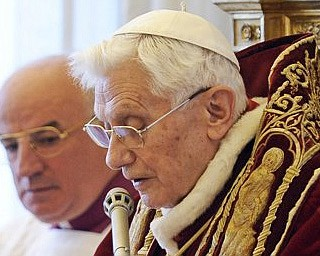 Pope Benedict XVI reads a document in Latin announcing his resignation during a meeting of Vatican cardinals at the Vatican on Monday.