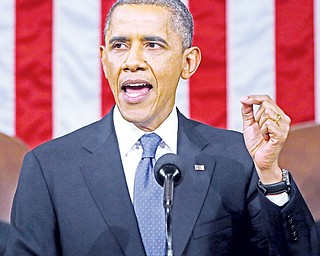 President Barack Obama gestures as he gives his State of the Union address Tuesday.