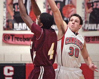 Canfield's Marco DeLorenzo blocks a shot by Liberty's Asim Pleas Jr. during the first quarter of Tuesday's game at Canfield High School.