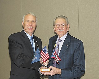 Col. Brian Anderson, left, U.S. Army retired, was recently presented with a flag set of the U.S. flag and state flags of Pennsylvania and Ohio by newly installed president Major Peter Mihai, U.S. Army retired. Anderson, retired deputy director of MOAA's Council & Chapter Affairs headquarters in Alexandria, Va., explained at the dinner what Military Officers Association of America is advocating for Congress in 2013 and installed the new board of directors of Mahoning Shenango Valley Chapter