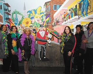 The Junior Civic League is planning a Mardi Gras party Saturday at The Georgetown in Boardman. Among those league members planning the event are, from left, Veronica Crafter-Srinivasan, left, committee chairwoman; Susan Moorer, president; Yvette Clark-Kirksey, co-chairwoman; and committee members Minerva Bonilla, Felicia Alexander and Sylvia Rupert.  MADELYN P. HASTINGS The Vindicator