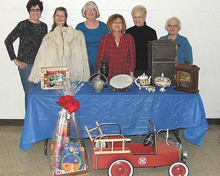 SPECIAL TO THE VINDICATOR Items on display will be auctioned during the Junior Group of Goodwill Antique and Collectible Auction at Stambaugh Auditorium on March 2. Volunteers are, from left, Kathy Gerberry, Chris Grabert, Diana Strudwick, Sue Miller, Jeri Kurian and Shirley Rodgers. The two-day event will begin with a gala March 1, also at Stambaugh.
