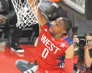West Team's Russell Westbrook of the Oklahoma City Thunder makes a layup against the East Team during the  first half of the NBA All-Star game Sunday in Houston.