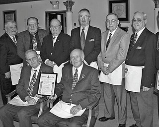SPECIAL TO THE VINDICATOR Argus Masonic Lodge 545 in Canfield recently paid tribute to 14 of its longtime members. Some of the lodge members are, from left standing, Allan G. Bohr, Ross D. Lucarell, John J. Koscelansky, Jerome A. Kovach, Richard A. Meshula, Paul Hershey, Ralph A. Ruggiero and Russell W. Gillam Jr.; and seated are Eugene W. Raupach and Glenn J. Ringer.