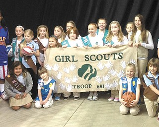 """SPECIAL TO THE VINDICATOR In honor of the first National Girl Scout Cookie Day Feb. 8, Harlem Globetrotters female star Fatima """"TNT"""" Maddox is pictured with Girl Scout Troop 80691 of New Middletown. Maddox joined the Globetrotters last year to become the first female player in almost 20 years. Maddox met the Girl Scout Troop at a private meet and greet before the recent Globetrotters game at the Covelli Centre in Youngstown. In honor of the Cookie Day, Maddox and teammates, Tammy """"T-Time"""" Maddox and Ariel """"Mighty"""" Mitchell joined forces with their local hometown Girl Scout councils and registered as adult Girl Scouts of the U.S."""