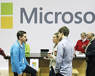 Microsoft Corp. retail store employees and guests mingle at a pop-up Microsoft Store during Microsoft's annual meeting of shareholders in Bellevue, Wash. Longtime users of Hotmail, MSN and other Microsoft email services will start noticing a big change: When they sign in to check messages, they'll be sent to a new service called Outlook.com.