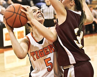 Springfield's Baylee Felger (5) is unable to shoot past Pymantuning Valley's Kelsea Brown (3) during their Division III sectional final Thursday at Mineral Ridge High School. The Tigers fell to the Lakers, 68-42.
