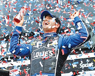 Jimmie Johnson celebrates winning Sunday's Daytona 500 at Daytona International Speedway in Daytona Beach, Fla. Johnson won the race for the second time, but it was Danica Patrick who earned a first by becoming the first woman to lead a lap in a race in Nascar's top series.