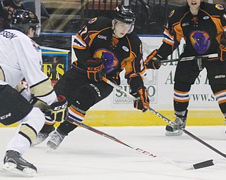Phantoms forward Luke Stork (27) moves to keep the puck away from Muskegon defenseman Rasmus Bengtsson, left, during Sunday's game at the Covelli Centre. The Phantoms won 3-2 in a shootout.