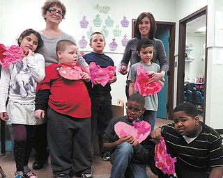 Ten children in first grade at the Rich Center for Autism made valentines out of tissue paper and stickers that were presented by their teachers to residents at Park Vista. The students also visited Park Vista. Two of the teachers are, from left, Grace Naji and Beth Maurice. The children pictured standing are Destiny Lopez, left, J.J. Juhasz, Hunter Gonzales and Christopher Roberts, and kneeling are A.J. Walton and Eian Mason.
