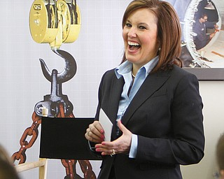 Lt. Gov. Mary Taylor said the governor's tax proposal, including a 50 percent cut for small businesses, will benefit the state's economy. Taylor spoke Monday with local business owners at an event at City Machine Technologies Inc. in Youngstown.