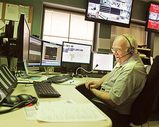 Dispatcher Bill Davis checks a multitude of screens and readouts in the new Boardman-Austintown joint dispatch center. The departments joined to get a digital radio system to comply with federal mandates, and the Mill Creek Metroparks have joined with the system.