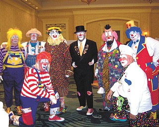 SPECIAL TO THE VINDICATOR Aut Mori Grotto recently sent 22 members to Orlando, Fla., for a national clown competition. As a group, they won five first-place and two second-place awards. Kneeling are Glen (Harlee) McClain, left, and Alan (It's So) Boles; and standing, from left, are Joe (Woodee) Humansky, George McClelland, Jay (JJ) Lasasso, Robert (Who Me) Edwards, Charles (Crackers) Graham and Jesse (Pokey) Boles. Alan Boles won first place in the character clown competition; Humansky won first place in the Auguste cagetory and first place in the balloon skit division; Jesse Boles won first place and Lasasso second place in the white face competition; and Edwards won first place and Graham won second place in the tramp clown competition.