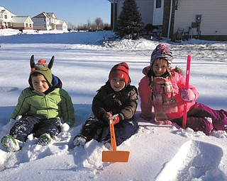 Snow days can definitely make kids smile! Marc, Luke and Ava McGovern of Aurora enjoy playing outside. Photo sent in by Nana and Papa Oleyar.