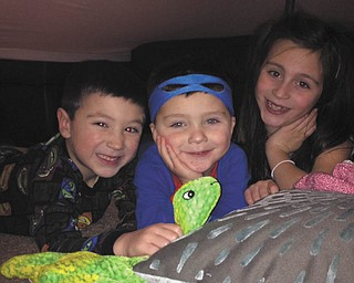 Blanket-and-pillow forts and childhood go hand-in-hand. Luke, Marc and Ava McGovern of Aurora enjoy theirs. Photo sent in by Nana and Papa Oleyar.