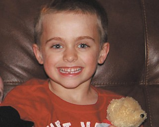 Joshua Guy of Poland loses his first tooth. Photo sent in by Jackie Cannatti of Poland.