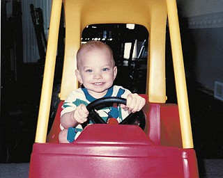 Jared Remias of Canfield was a toddler when this picture was taken by his mom, Sheila Remias. He's now 20 and still lights up the world with his smile, she says.