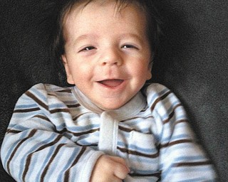 Lorenzo Michael Testa of Boardman was two months old when he giggled and smiled for his big sister, Sophia, at Christmas.