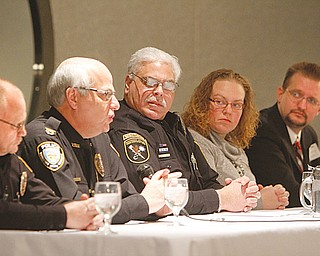 These panelists talked about tools to handle life-and-death situations at Mr. Anthony's Banquet Center in Boardman on Thursday. From left, Sgt. Ken Goist, school-resource officer with Springfield schools; police Chief Vincent D'Egidio of New Middletown; Michael Cretella, deputy chief of YSU Police; Jessica Jaros, disaster supervisor with Red Cross; and Steve Ruggles, operations director for Master Security Inc.