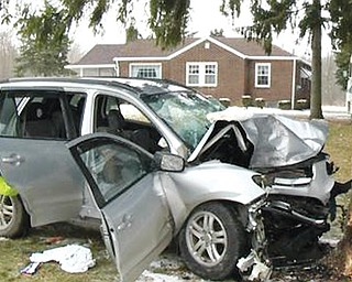 This Hyundai Sante Fe sport-utility vehicle crashed into a tree on New Castle Road in Poland Township on Sunday afternoon, killing two and seriously injuring one.